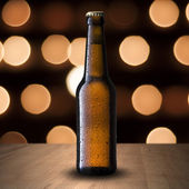Fresh cold beer on beautiful bokeh background — Stock Photo