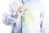 Male businessman hand drawing light bulb. — Stock Photo