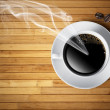 Hot cup of coffee on wood table — Stock Photo