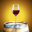 Red wine on wood barrel — Stok fotoğraf