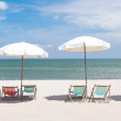 Beach chairs with umbrella and beautiful beach — Stock Photo