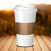 Take away coffee cup on wood table — Stock Photo