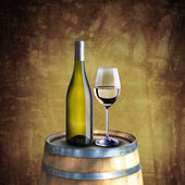 White wine bottle and glass on wood barrel — Stock Photo