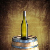 White wine bottle on wood barrel — Stock Photo