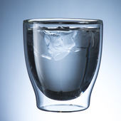 Glass of cold water with ice — Stock Photo