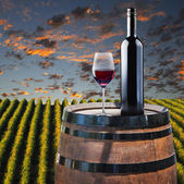Red Wine in glass on wood barrel — Stock Photo