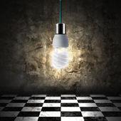Light bulb in empty room — Stock Photo