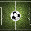Ball on the grass of soccer field — Stockfoto