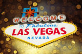 Welcome to Las Vegas Sign with golden bokeh — Stock Photo