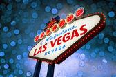 Välkommen till las vegas-skylten med blå bokeh — Stockfoto