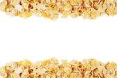 Crispy corn flakes heaped — Stock Photo
