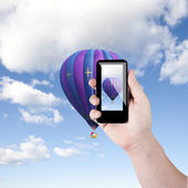 Cell phone in hand take photo of beautiful balloon and sky view — Stock Photo