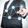 Stock Photo: Businessmselecting network