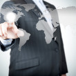 Business man pointing on the touch screen with world map — Stock Photo