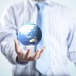 Business man with the digital globe ball — Stock Photo
