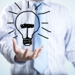 Male businessman with light bulb — Stock Photo