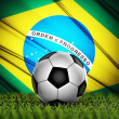 Soccer ball with Brazil flag on background — Stock fotografie
