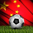 Soccer ball with China national flag on background — Stock Photo