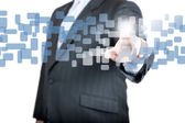 Businessman hand pushing on a touch screen interface — Stock Photo