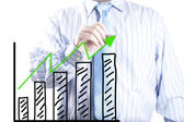Businessman hand drawing the increase graph — Stock Photo