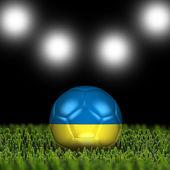 Ot siyah arka plan üzerinde futbol topu — Stok fotoğraf