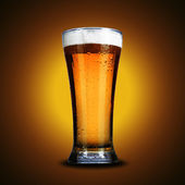 Cold glass of light beer — Stock Photo