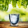 Glass of Water on wood table — Stock Photo