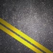 Asphalt road texture with yellow stripe — Stock Photo
