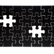 Black jigsaw puzzle with missing piece  — Stock Photo