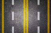 Asphalt road texture with white and yellow stripe — Stok fotoğraf