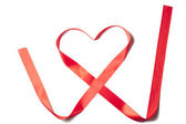 Red Satin Ribbon forming Heart shape — Stock fotografie