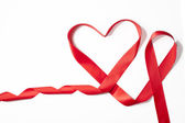 Red Satin Ribbon forming Heart shape — Zdjęcie stockowe