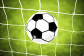 Soccer ball goal on the net — Stock Photo