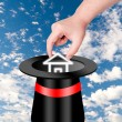 Hand pick up house from magic hat — Stock Photo #36470065