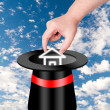 Hand pick up house from magic hat — Stock Photo #36470097