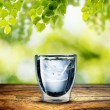 Glass of Water on wood table — Stock Photo #38347435