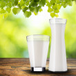 Milk on wood table — Stock Photo