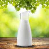 Milk with leaves — Stock Photo