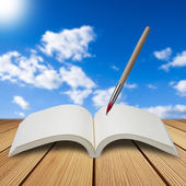 Paint brush with book — Stock Photo