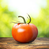 Tomato On Wood Table — Stock Photo
