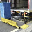Tail lift loading crates on a truck — Stock Photo