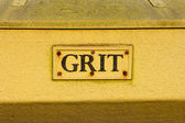 Closeup to the words on a grit container — Stock Photo