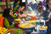 People buying food at Camden Food Market — Stock Photo