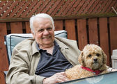 Elderly Man and Dog — Stock Photo