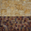 Stone wall of bricks in two colors — Stock Photo
