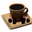 A cup of black coffee with chocolate candies — Stock Photo #31815115