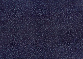 Texture of dark blue cloth with silver and blue sequins as backg — Stock Photo