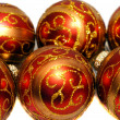 Composition of red Christmas balls with golden pattern — Stock Photo #36721457