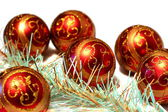Composition Christmas red balls with gold pattern and tinsel — Stock Photo