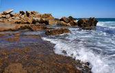 Huge rocks on the coast of the storm sea — Stock Photo